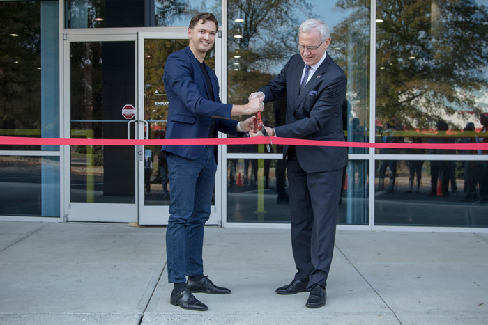 Latvian print company's ribbon cutting celebrates new Charlotte branch and millionth printed t-shirt